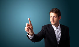Man pressing an imaginary button on bokeh Royalty Free Stock Images