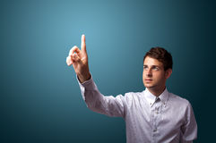 Man pressing an imaginary button on bokeh Stock Photos