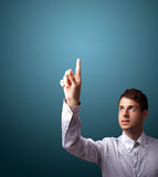 Man pressing an imaginary button on bokeh Royalty Free Stock Photo