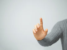 Man pressing imaginary button. Bright picture of man pressing imaginary button Royalty Free Stock Photography