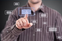 Man pressing mail symbol Stock Photography