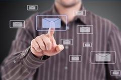 Man pressing mail symbol Stock Photography