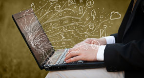 Man pressing notebook laptop computer with doodle icon cloud sym. Man pressing notebook laptop computer with doodle icon media cloud symbols Stock Image