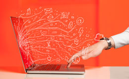 Man pressing notebook laptop computer with doodle icon cloud sym Stock Photo