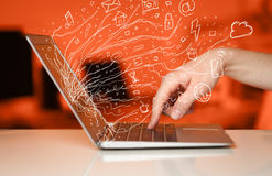 Man pressing notebook laptop computer with doodle icon cloud sym. Man pressing notebook laptop computer with doodle icon media cloud symbols Royalty Free Stock Photos