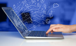 Man pressing notebook laptop computer with doodle icon cloud sym. Man pressing notebook laptop computer with doodle icon media cloud symbols Royalty Free Stock Image