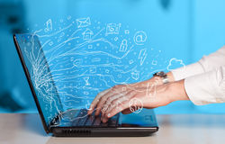 Man pressing notebook laptop computer with doodle icon cloud sym. Man pressing notebook laptop computer with doodle icon media cloud symbols Stock Photos