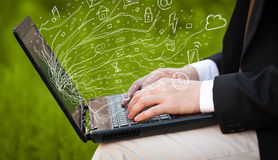Man pressing notebook laptop computer with doodle icon cloud sym. Man pressing notebook laptop computer with doodle icon media cloud symbols Stock Photo