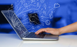 Man pressing notebook laptop computer with doodle icon cloud sym. Man pressing notebook laptop computer with doodle icon media cloud symbols Stock Photography