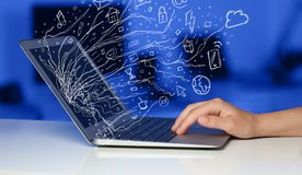 Man pressing notebook laptop computer with doodle icon cloud symbols. Man pressing notebook laptop computer with doodle icon media cloud symbols Stock Image