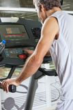 Man Pressing Program Button on Treadmill Stock Image