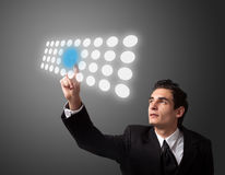 Man pressing a touchscreen button Royalty Free Stock Photo