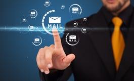Man pressing virtual messaging type of icons royalty free stock photos