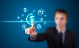 Man pressing virtual messaging type of icons Stock Photo