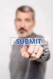 Man pressing virtual submit button. Senior man pointing his finger towards camera Royalty Free Stock Photos