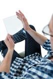 Man pretending to be using futuristic digital tablet Stock Photo
