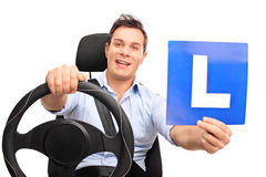 Man pretending to drive and holding an L-sign Stock Image
