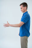 Man pretending to hold Royalty Free Stock Photography
