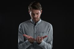 Man pretending to hold an invisible object Royalty Free Stock Photo