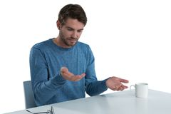 Man pretending to hold an invisible object Stock Image