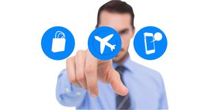 Man pretending to touch airplane mode icon against white background. Digital composition of man pretending to touch airplane mode icon against white background stock images