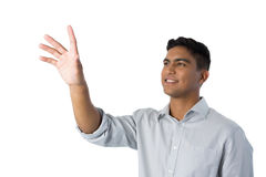 Man pretending to touch an invisible screen Royalty Free Stock Image