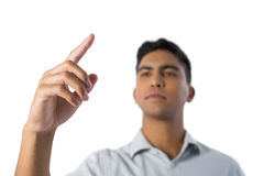 Man pretending to touch an invisible screen Royalty Free Stock Photo