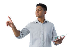 Man pretending to touch an invisible screen Royalty Free Stock Photography