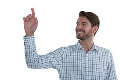 Man pretending to touch an invisible screen Royalty Free Stock Photos