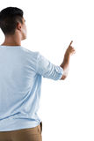 Man pretending to touch an invisible screen against white background Royalty Free Stock Photo