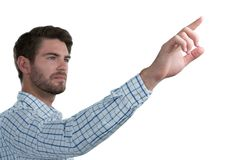Man pretending to touch an invisible screen Royalty Free Stock Images