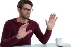 Man pretending to use an invisible screen Stock Photos