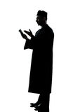 Man priest silhouette reading bible Stock Images