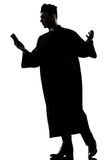 Man priest silhouette reading bible Royalty Free Stock Image