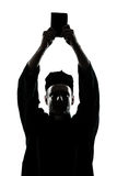 Man priest wrath of god silhouette Royalty Free Stock Photography