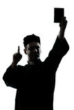 Man priest wrath of god silhouette Stock Photo
