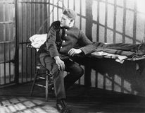 Man in prison cell. (All persons depicted are no longer living and no estate exists. Supplier grants that there will be no model release issues Stock Images