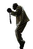 Man prisoner criminal with chain ball silhouette Royalty Free Stock Photography