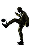 Man prisoner criminal playing soccer ball. One caucasian man prisoner criminal playing soccer with chain ball in studio isolated on white background royalty free stock photography