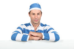 Man in prisoner outfit Stock Image