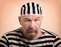 Man prisoner. Portrait of a man prisoner in prison garb Royalty Free Stock Photos