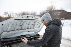 Man problem close to the broken car in winter. A Man problem close to the broken car in winter Royalty Free Stock Images