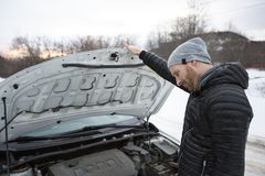 Man problem close to the broken car in winter. A Man problem close to the broken car in winter Stock Photo