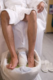 Man and the procedure of pedicure Stock Image
