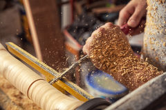 Man processes a wood on a lathe Royalty Free Stock Images