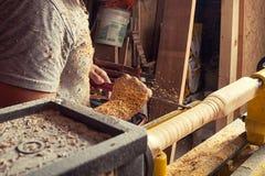 Man processes a wood on a lathe Royalty Free Stock Photos