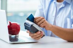The man processing credit card transaction with pos terminal royalty free stock image