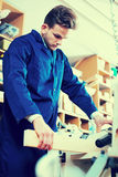 Man processing plank at workshop Royalty Free Stock Image