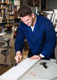 Man processing plank at workshop Royalty Free Stock Photography