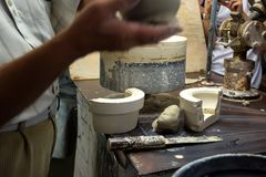 Man produces earthenware pot Royalty Free Stock Images